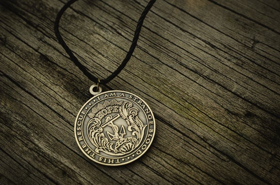 Image of THIS THE RESCUE vintage coin necklace