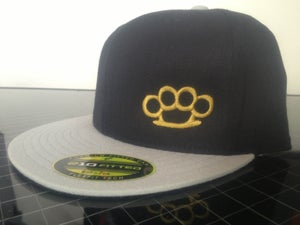 Image of FLAT BILL TWO TONE BRASS KNUCLE HAT