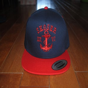 Image of .navy.red.snapback.