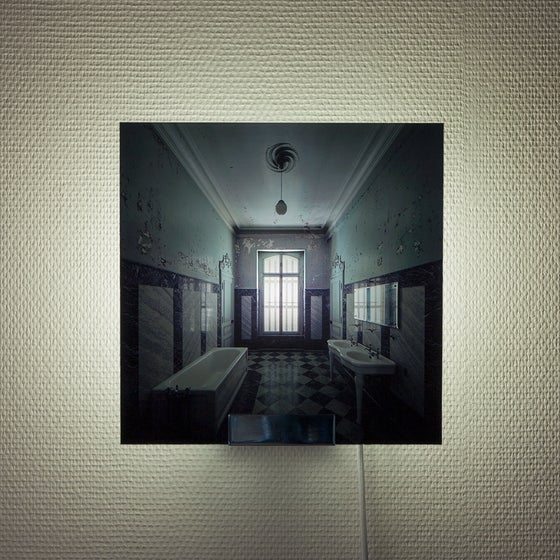 Image of 'Lux Interna', limited edition sconce, picturing the photo of an abandoned grand bathroom