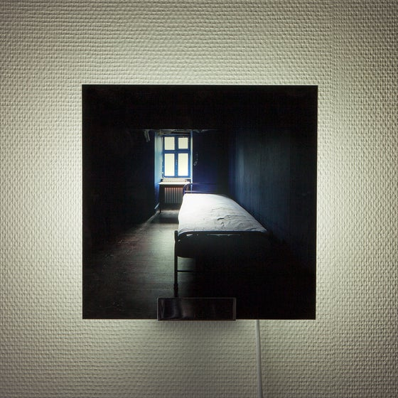 Image of 'Bonsai', limited edition sconce, picturing the photo of an abandoned bedroom