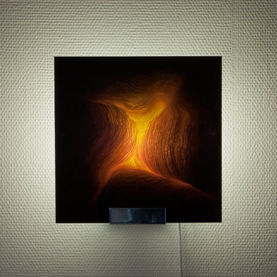 Image of 'Gitanes', limited edition sconce, picturing a chiaroscuro photography