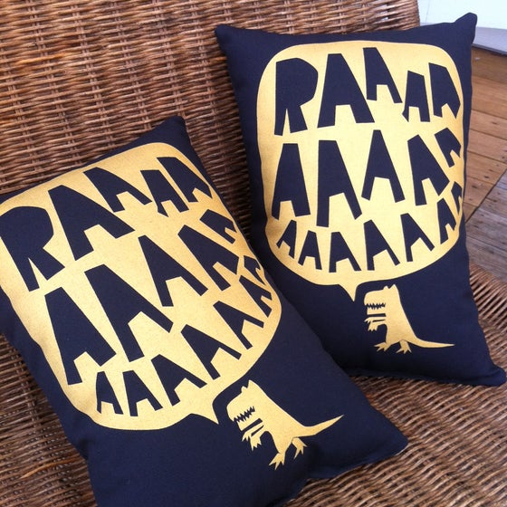 Image of RAAAAA Dinosaur Cushion - Gold on Black