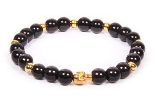 Image of Beaded goldtone/black skull bracelet