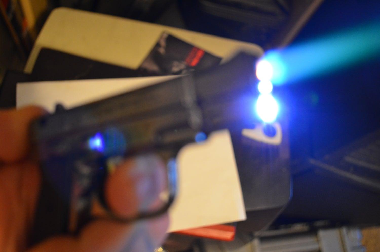 Image of Gun Lighter + LED flashlight combo