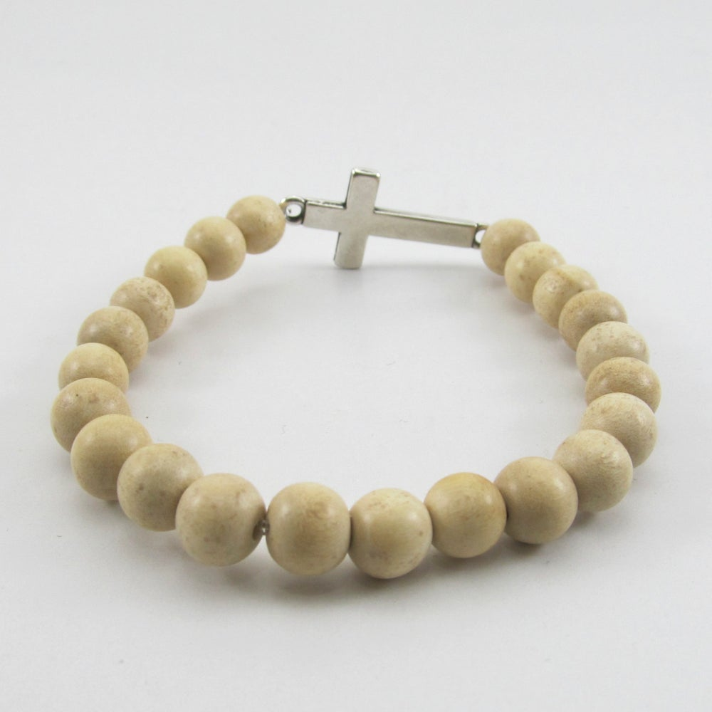 Image of Natural beaded stretch bracelet with sideways cross