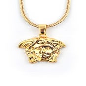 Image of Gold god medusa piece