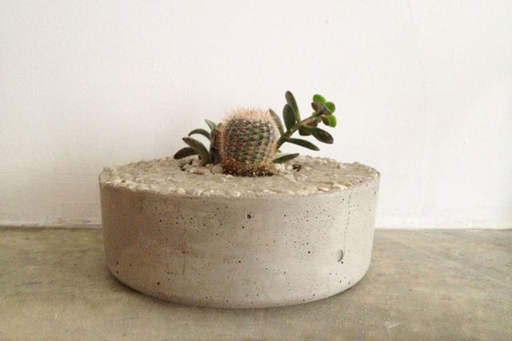 Image of plain concrete planter