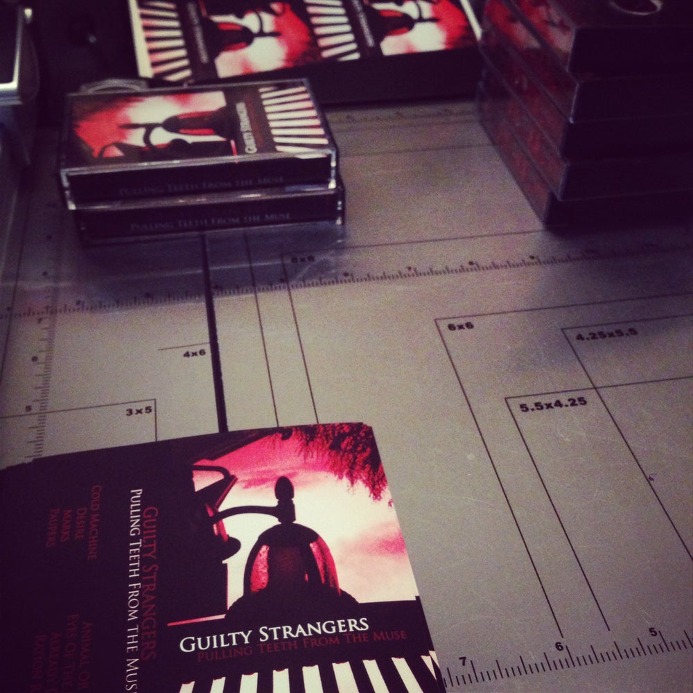 "Image of Guilty Strangers ""Pulling Teeth from The Muse"" Cassette Tape"
