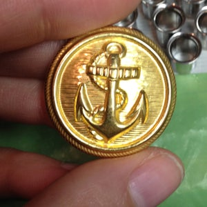 "Image of Gold Anchor Plugs (sizes 0g-1"")"