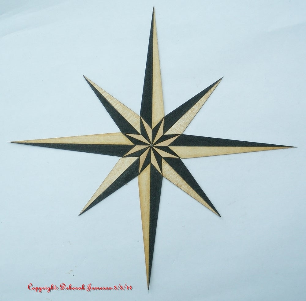 Image of Item No. 72. **HAND CUT**  Marquetry Inlay Nautical Compass Star.