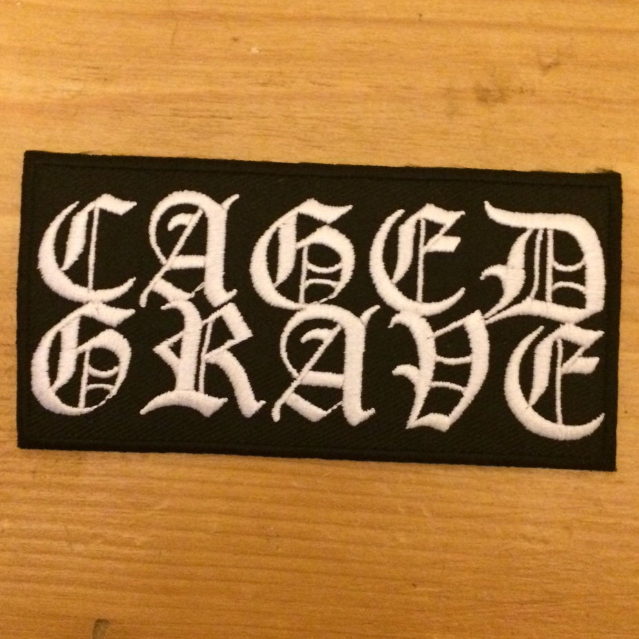 """Image of Caged Grave - Woven """"Iron-on"""" Logo Patch"""