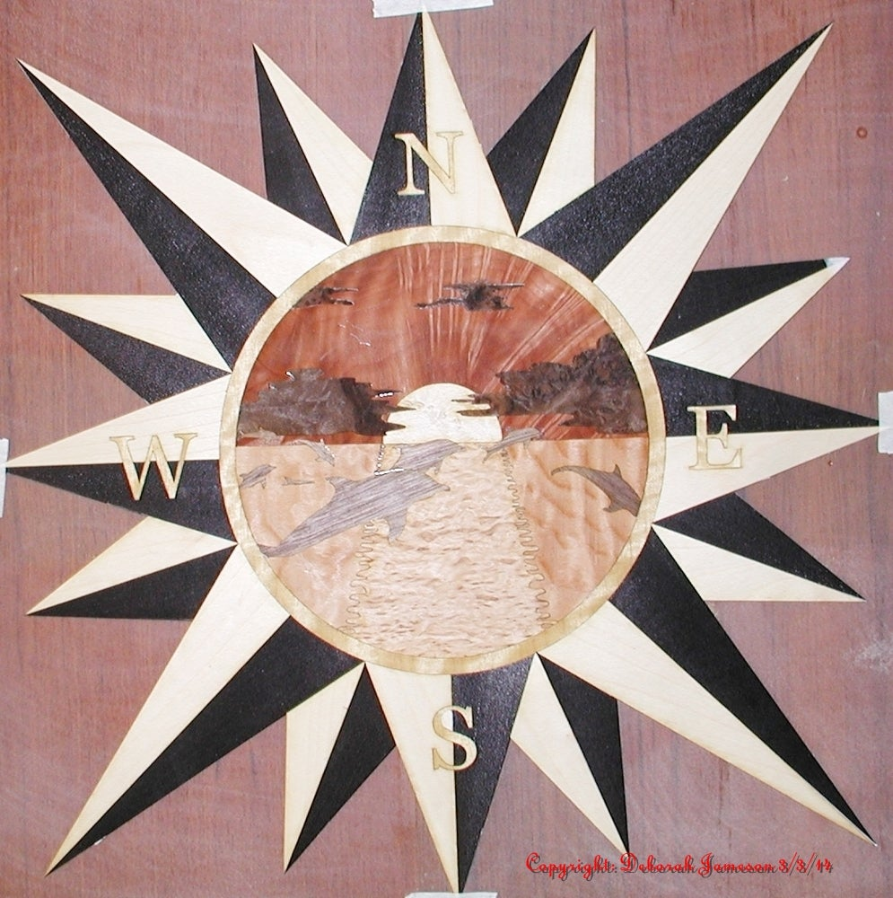 Image of Item No. 122. Star with Marquetry detail of a Lighthouse.