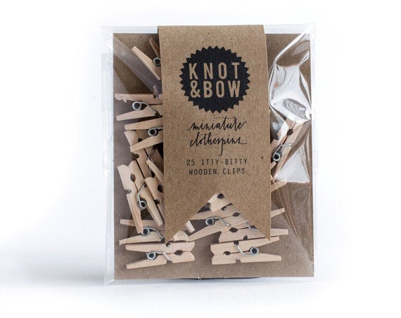 Image of 25 miniature wooden clothespins