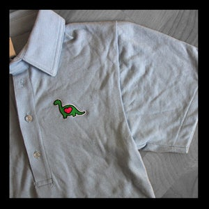 Image of EMBROIDERED DINO POLO SHIRT (Light Blue)