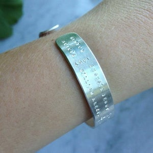 Image of Open bracelet with all over text