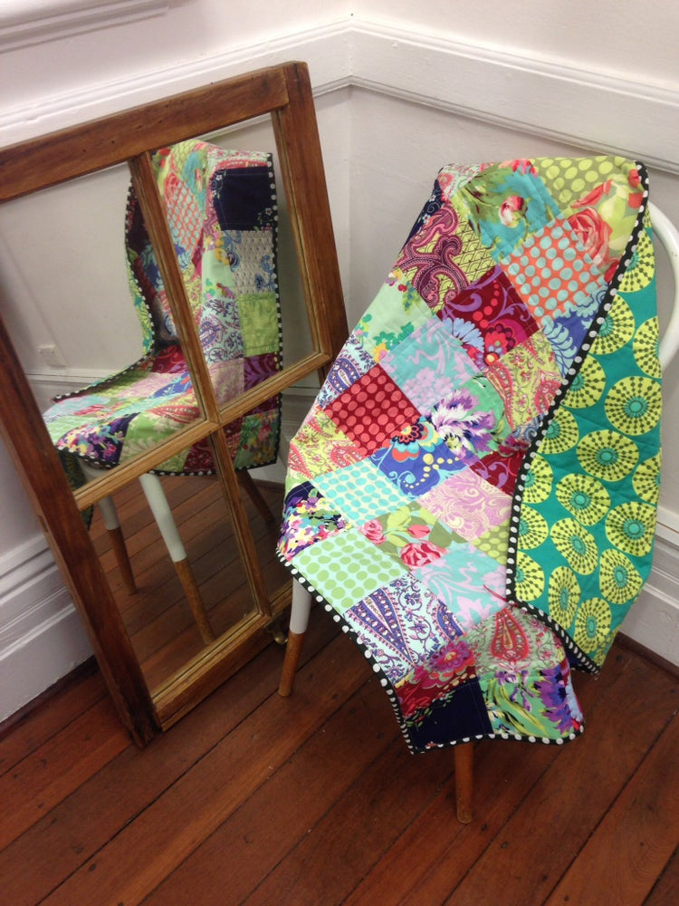 Image of 'Love' patchwork baby quilt