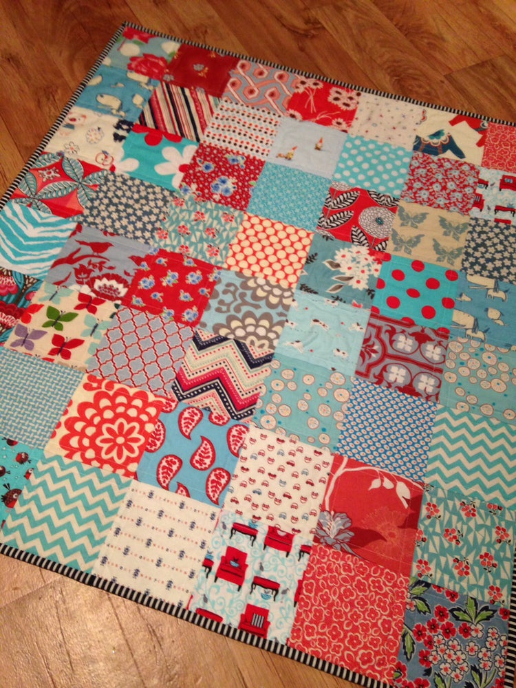 Image of Red & Aqua patchwork baby quilt