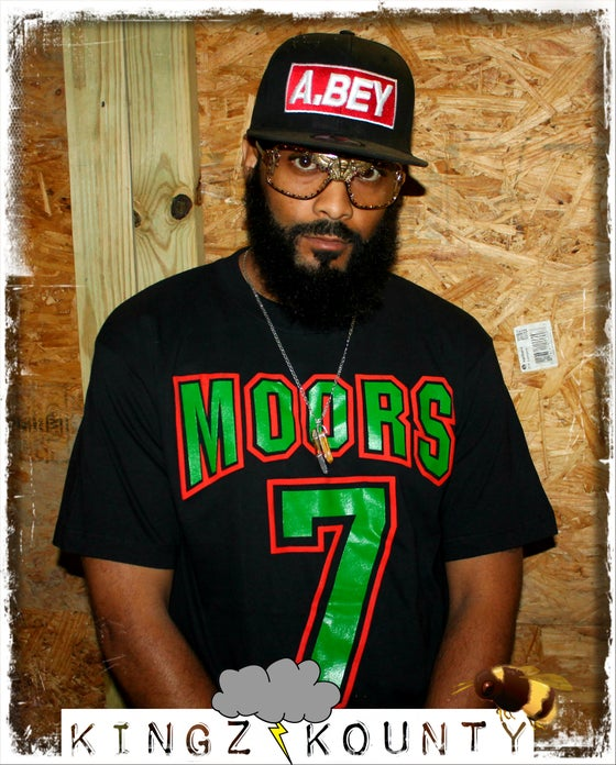 Image of MOORS 7 RED BLACK & GREEN TSHIRT