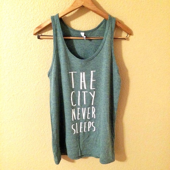 Image of THE CITY NEVER SLEEPS tank in Teal