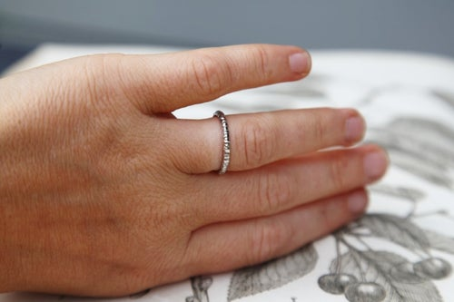 Image of platinum 2mm faceted ring