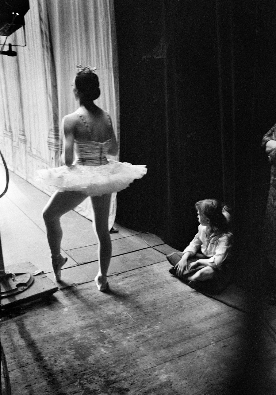 Image of Ballerina waits for her cue; a younger girl waits, too