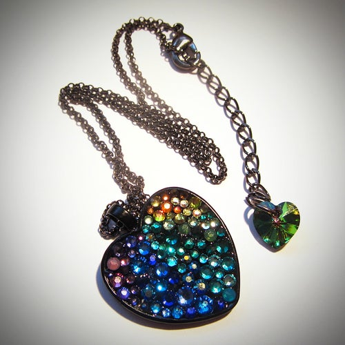 Image of Peacock Rocks Black Heart Pendant