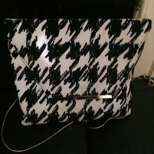Image of Black and white houndstooth jumbo clutch