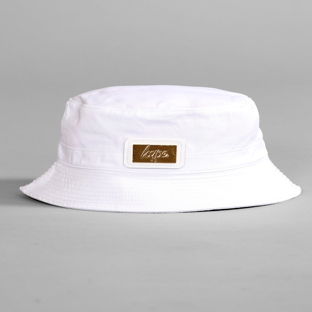 Image of HYPE. WHITE BUCKET HAT WITH GOLD PATCH