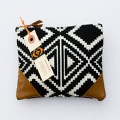 Image of medium black + white geometric woven zip clutch