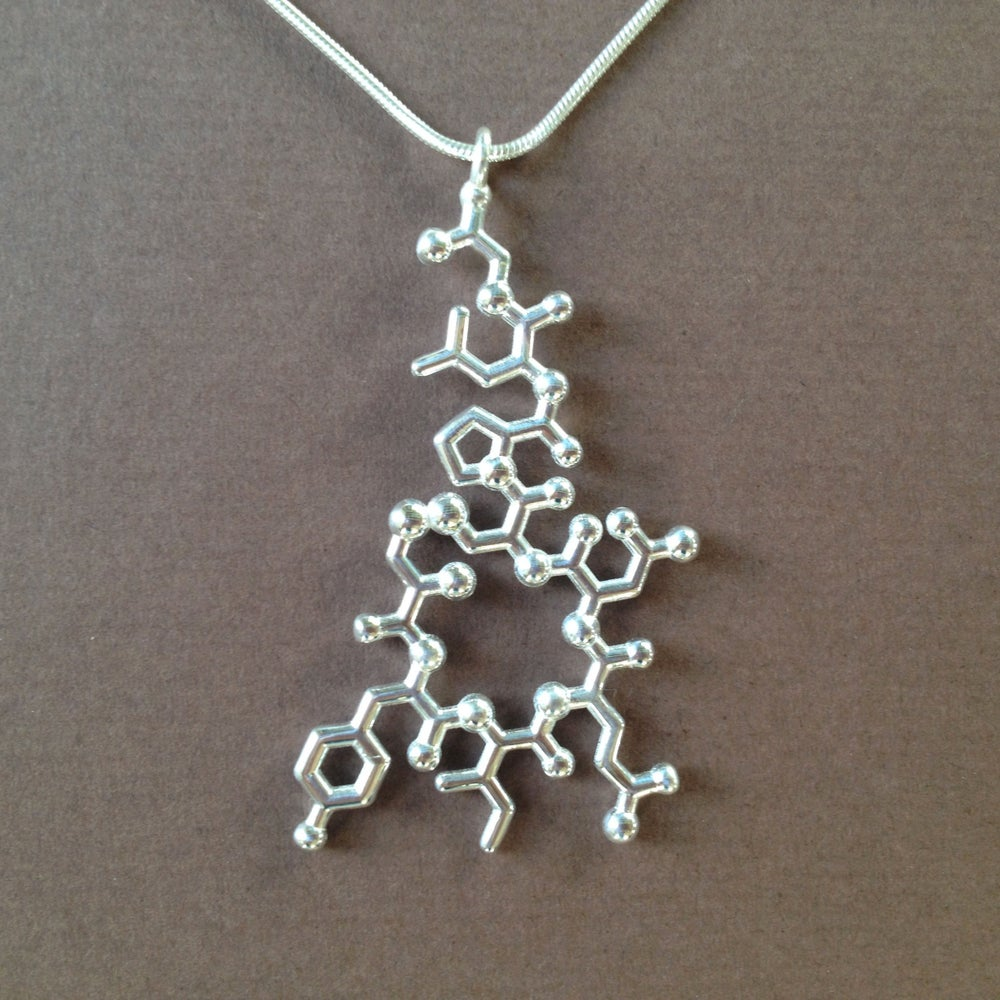 made with molecules oxytocin necklace dangling