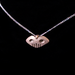 Image of HEART-SHAPED SKULL PENDANT