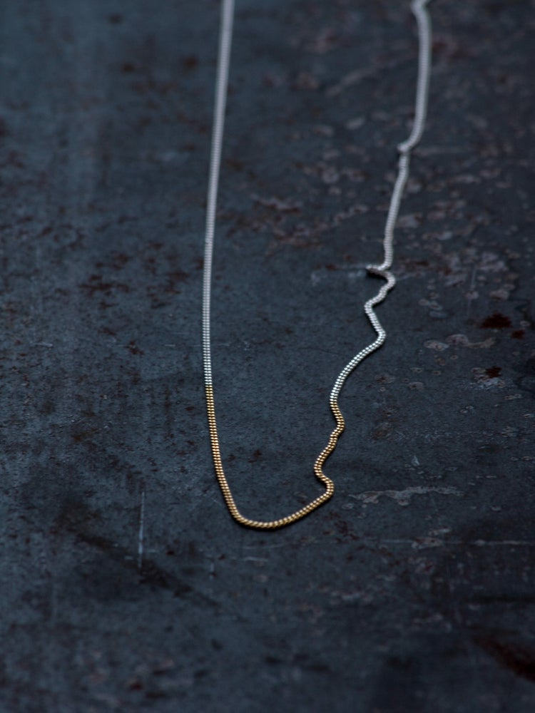 DELICATE NECKLACE WITH A FLASH OF GOLD  Delicate 1mm high quality 925 Silver gourmet chain necklace, 60cm long, with 10cm gold plated section and spring clasp.  Sold out for the moment, will be back in a small period, making a pre-order is possible