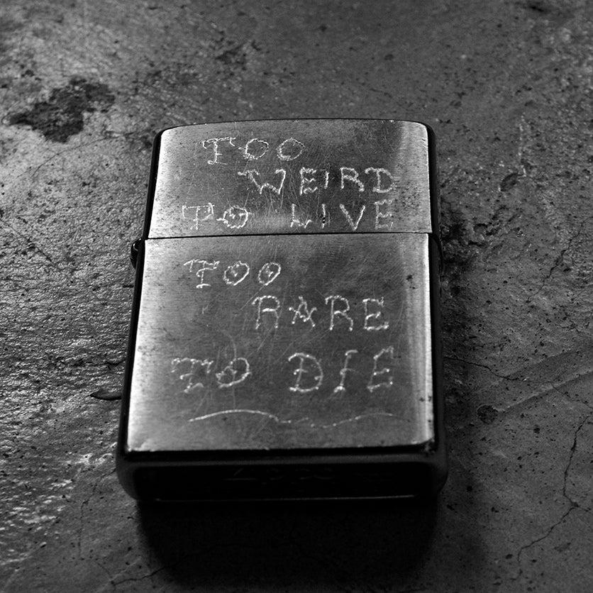 Image of WEIRD x ZIPPO  engraved lighter