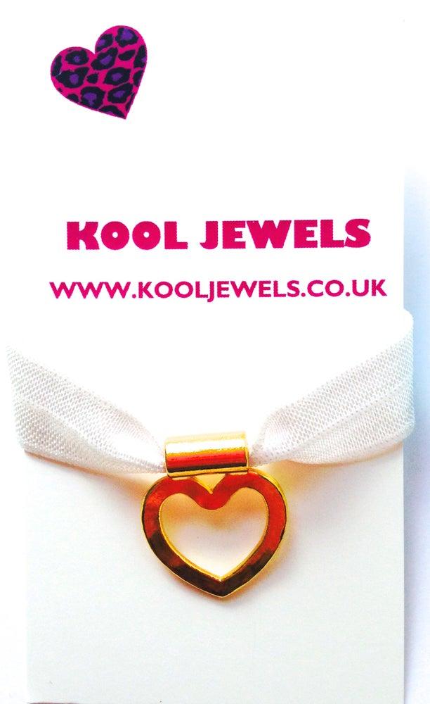 Image of Stretch goldtone heart charm bracelet