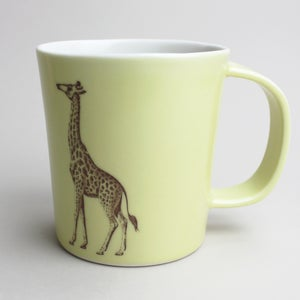 Image of 16oz mug with giraffe, mustard