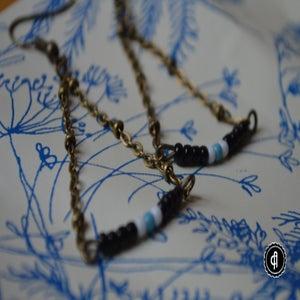 Image of Boucles d'oreilles Savannah rocaille noire