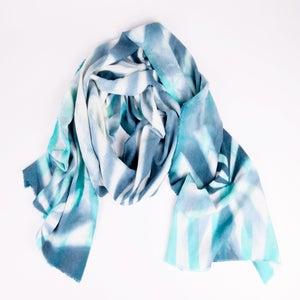 Image of shibori dyed pinwheel with stripe scarf in blue