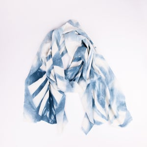 Image of shibori dyed pinwheel scarf in blue
