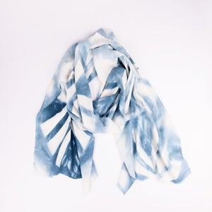 Image of shibori dyed pinwheel scarf in blue