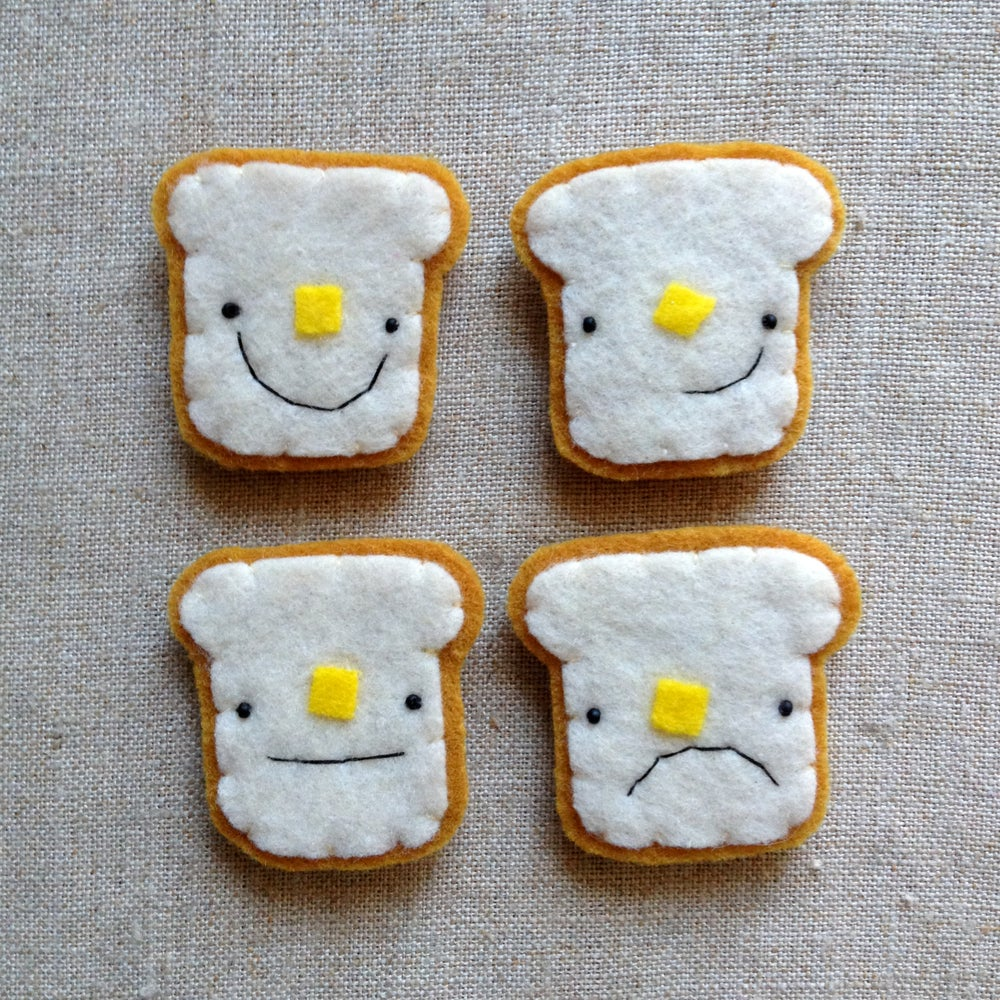 Image of buttered toast magnet // choose happy, smirking, grumpy or meh