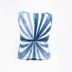 Image of navy pinwheel pillow