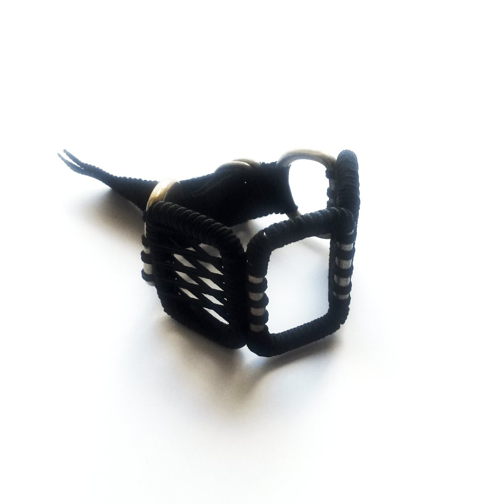 Image of medium woven bracelet #1041, color 1S or 10B (limestone/silver or carbon/bronze)