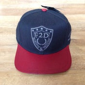 Image of F2D x STARTER CUSTOM RED LEATHER BRIM SNAPBACK