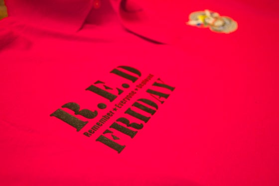 "Image of Show your support for ""R.E.D Friday"" Polo Shirt"