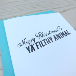 Image of merry christmas ya filthy animal letterpress card
