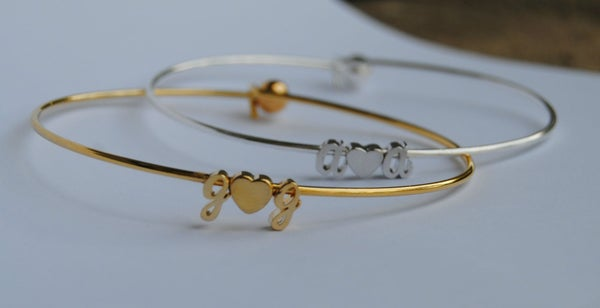 Image of $20 Sale Tiny Cursive Initial Love Bangle