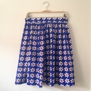 Image of 'High Tea' skirt in Royal Blue with Daisy print