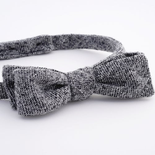 Image of the sky line / black + white tweed bow tie