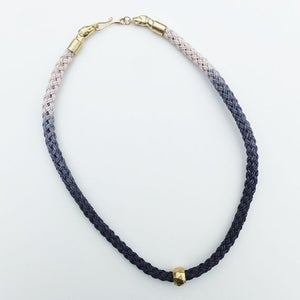 Image of Brass Dog Necklace with Gray and White Cotton Cord and Brass Bead
